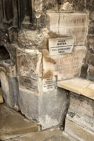 1978 North Sea storm surge - Close-up of the flood markers, at the western entrance door of St Margaret's Church King's Lynn that denote the extraordinary height to which flood water rose at certain times in history, the highest being in 1978, which was due to a North Sea surge.