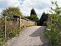 Footbridge at Woodley - geograph.org.uk - 1279224.jpg