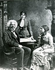 Frederick Douglass with his second wife Helen Pitts Douglass and her sister (standing), c. 1884