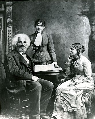 Helen Pitts Douglass - Pitts, seated, with Frederick Douglass. The standing woman is her sister, Eva Pitts.