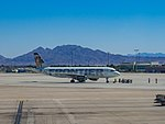 Frontier Airlines A320 N214FR (29311160050).jpg