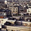 Gezicht over de stad vanuit hotel Le Vendome - Stichting Nationaal Museum van Wereldculturen - TM-20037987.jpg