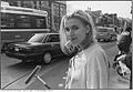 Girl with squeegee, north-east corner of Queen Street West and Bathurst Street.jpg