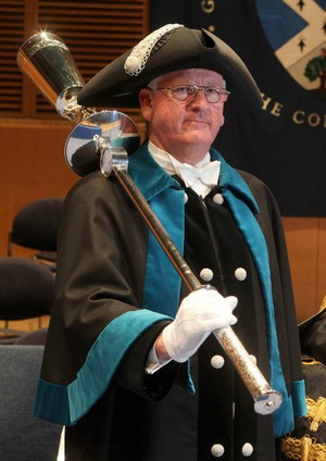 Beadle - The Ceremonial Bedellus of Glasgow Caledonian University carrying the University's Ceremonial Mace