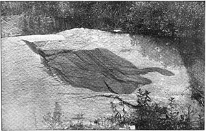 Woodstock Quartz Monzonite - Inclusion (Xenolith) of Baltimore Gneiss in a wall of Waltersville Quarry (c. 1895.)
