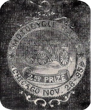 "Motocycle - Gold Metal award for 2nd Prize of America's first automobile race in Chicago on November 28, 1895, reads ""Motocycle Race, 2nd Prize, Chicago Nov 28 1895"". Reverse side says ""Presented to Charles B. King, Umpire by H. Mueller Mfg. Co. Decatur, Ill."""