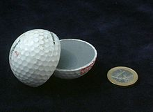 Golfball with a tough rubber core (with 1 Euro coin for size reference)