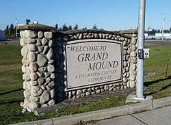 Town sign for Grand Mound, located at main intersection
