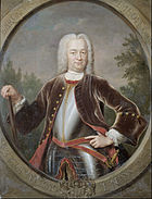 A portrait of Governor-General van Imhoff in a large white wig and black suitcoat over plate armour. He is carrying a cane in his left hand and has a sword sheathed on his right side.