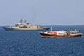 HMAS Anzac (FFH 150) is underway alongside a dhow in the Gulf of Aden..jpg