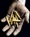 Hand Holding 5.56mm Bullets MOD 45150253.jpg
