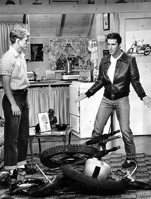 Happy Days - Richie and Fonzie view his destroyed motorcycle in his living room, 1976. Fonzie's apartment was over the Cunninghams' garage