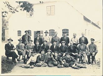 Hästens - David Janson (to the left) and master craftsmen photographed by David in front of the Hästens factory in Köping in the beginning of the 1900s