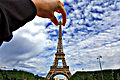 Holding the eiffel tower (4114302348).jpg