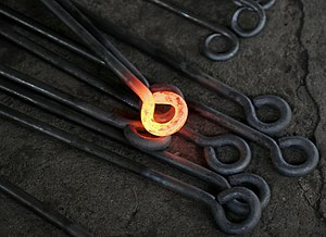 Hot metalwork from a blacksmith. The yellow-or...