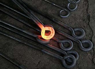 Metal - Hot metal work from a blacksmith.