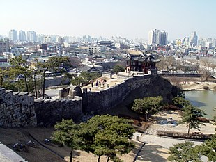 "<a href=""http://search.lycos.com/web/?_z=0&q=%22Hwaseong%20Fortress%22"">Hwaseong Fortress</a> and the skyline of Suwon"
