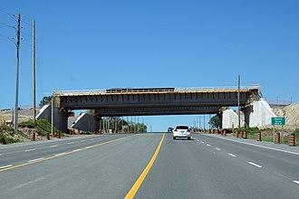 Ontario Highway 412 - Highway 7 passing westerly beneath the still under construction Highway 412 overpass, in June 2015