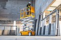 Hy-Brid Lifts PS-1930 scissor lift with worker working while elevated.jpg