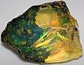 Hydrophane opal (precious opal) immersed in water (Tertiary; Ethiopia) 1 (32332088570).jpg
