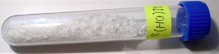 Sample of aluminium hydroxide in a vial