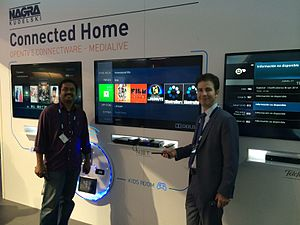 OpenTV - NAGRA Connected Home Demo at IBC 2014 in Amsterdam. From left to right on the screens Starhub, NET and Telefónica UIs running on OpenTV 5 platform