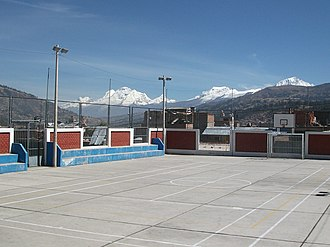 Huaraz - Soccer field in Huaraz with the snow-covered peak of the Huascaran in the background.