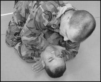 Combatives - A sleeve choke (executed from the mount)