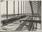 Installing overhead wiring on Harbour Bridge, 1932 (8282709037).jpg