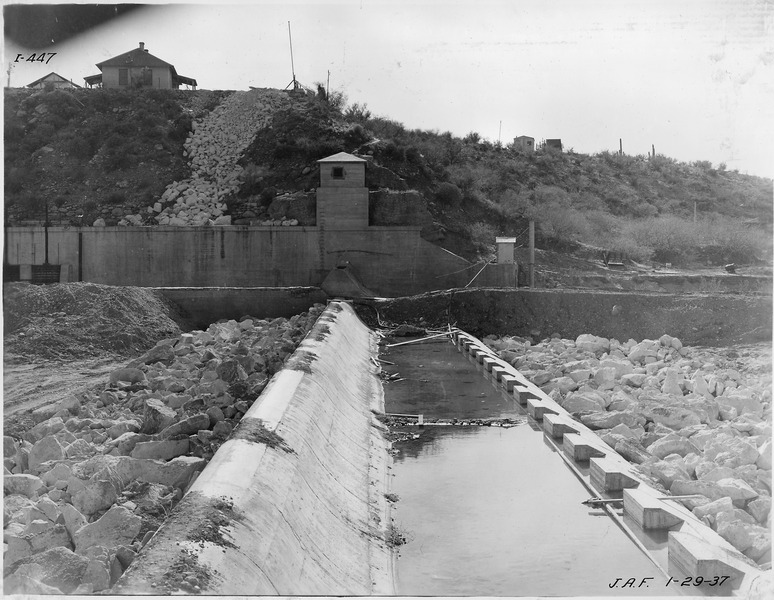 File:Intake diversion dam. View looking toward sluiceway structure and left abutment showing riprap. - NARA - 294583.tiff