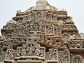 Intricate art in multi-tiered tower over shrine in Veeranarayana temple at Belavadi.jpg