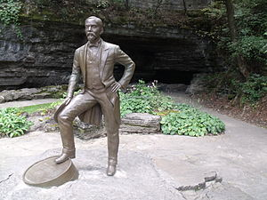 Jack Daniel's - Statue of Jack Daniel in front of the fresh water spring from whence he drew the water for producing his whiskey.  Current production draws water about 150 yards further back from the grotto. (Jack Daniel's Distillery, Lynchburg, Tennessee)