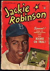 "A comic book cover titled ""Jackie Robinson"" depicts a black man in a Brooklyn Dodgers cap; inset image on the cover shows a black baseball player covering a slide at second base."