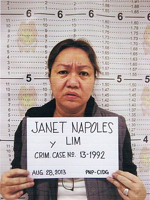"Filipino name - Mug shot of Janet Lim-Napoles with her name on a placard showing ""Janet Napoles y Lim"". Notice the use of Spanish order of paternal and maternal surnames, which are Napoles and Lim, respectively, separated by the particle ''y''"