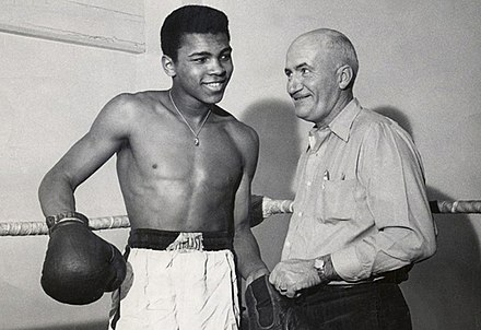 Cassius Clay and his trainer, Joe E. Martin (1960). JoeEMartinCassiusClay1960.jpg
