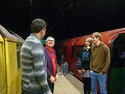 John LT Museum Volunteer chatting in front of 1934 S Stock (6367326395).jpg