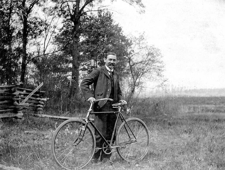 John N Cobb with bicycle, Hatteras, North Carolina, 1898 (COBB 330).jpeg