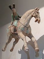 A Tang woman playing polo on a horse, 8th century.