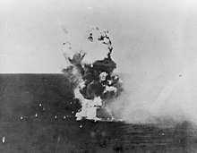 Kamikaze hits USS Columbia (CL-56) in Lingayen Gulf on 6 January 1945 (NH 79450).jpg