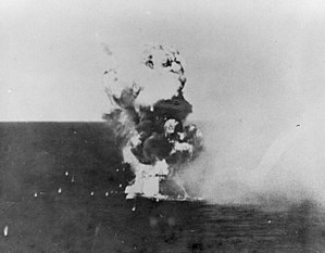 USS Columbia (CL-56) - The kamikaze hits Columbia at 1729. The plane and its bomb penetrated two decks before exploding, killing 13 and wounding 44.