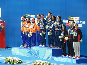 Simone Manuel - Lochte, Adrian, Manuel, and Franklin (center, left to right) together hold the mixed 4 × 100 m medley relay world record.