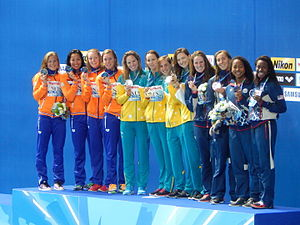Tracksuit - The Victory Ceremony of the women's 4×100 metres freestyle relay at the 2015 World Championships in Kazan; winners are wearing tracksuits. 2015.