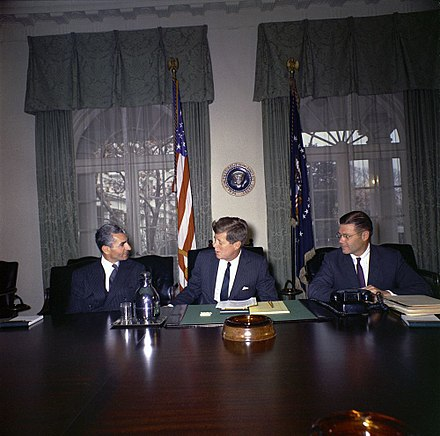 Mohammad Reza Pahlavi, Shah of Iran, Kennedy, and U.S. Defense Secretary Robert McNamara in the White House Cabinet Room on April 13, 1962 Kennedy with Shah of Iran, 1961.jpg
