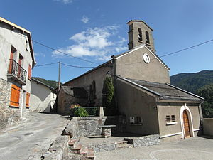 Ascou - The Parish church in Ascou. Next to the church is a small memorial for those who fell in the First World War