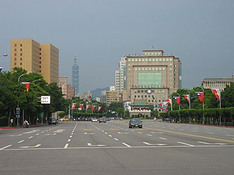 Ketagalan Boulevard - A view of Ketagalan Boulevard from the Presidential Building towards the East Gate (foreground): The prominent landmarks seen are the NTU Hospital (left), Taipei 101 (background), KMT former Headquarters (right), and ROC Foreign Ministry (far right). The route was lined with flags of the ROC and Kiribati during a state visit by President Anote Tong.