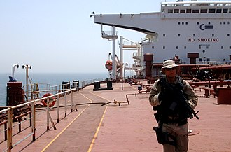 A member of USCG Law Enforcement Detachment (LEDET) 106 performing a security sweep aboard a tanker ship in the North Persian Gulf in July 2007 LEDET 106 in NAG.jpg