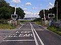 Level crossing, Frost Lane - geograph.org.uk - 539051.jpg