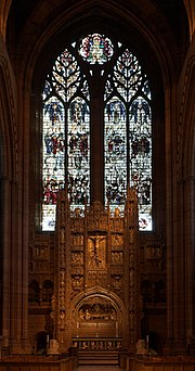 The eastern end of the cathedral featuring the high altar and stained glass window
