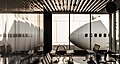 Lufthansa 747 rests next to a Frankfurt lounge (8112911569).jpg