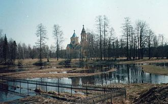 Tosnensky District - The Lustovka River with the Church of the Holy Cross in Lisino-Korpus in the background.